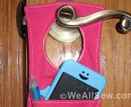 """Have a habit of misplacing your keys. Losing your iPod? Forgetting your coupons? Now, with this handy organizer, all your little necessities are in one convenient spot when you're ready to head out the door - right on the door knob! How to Make a Door Organizer Supplies 1/3 yard or heavyweight fabric such as twill, canvas, or denim 1/3 yard of fusible interfacing Coordinating thread Scissors Water-soluble marking pen or tailor's chalk Ruler 1/4"""" presser foot (BERNINA Patchwork Foot #37 or Patchwork Foot with Guide #57) Download and print the keyhole template: [download id=""""88""""] Step 1) Prepare the fabric pieces. Cut from the heavyweight fabric: Two 5"""" x 11"""" rectangles for the organizer body One 5"""" x 12"""" rectangle for the large pocket One 5"""" x 7"""" rectangle for the small pocket One 6"""" x 7"""" rectangle for the hanging pocket Fuse interfacing to the wrong side of both 5"""" x 11"""" fabric rectangles following the manufacturer's directions. How to Make a Door Organizer Cut the keyhole: Measure down 1"""" from the top edge of one 5"""" x 11"""" rectangle. Center the top of the keyhole template on this mark. Trace the template. Cut along the traced line. Repeat for the second 5"""" x 11"""" rectangle. How to Make a Door Organizer Step 2) Make the large and small pockets. With wrong sides together, fold the large pocket in half to create a 6"""" x 5"""" rectangle. Topstitch close to the folded edge. How to Make a Door Organizer Place the large pocket on top of the right side of one 5"""" x 11"""" rectangle, matching the raw edges along the sides and bottom edges. Baste in place. How to Make a Door Organizer With wrong sides together, fold the small pocket in half to create a 3 1/2"""" x 5"""" rectangle. Topstitch close to the folded edge. Place the small pocket on top of the large pocket, matching the raw edges along the sides and bottom edges. Baste in place. How to Make a Door Organizer Step 3) Make the hanging pocket. With wrong sides together, fold the 6"""" x 7"""" rectangle in half lengthwise. Press. How to Make """