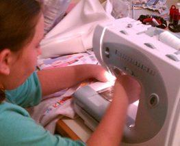 kaysie -- granddaughter at machine 315x214px