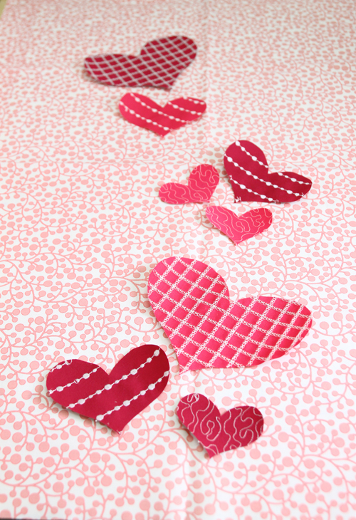 arrange hearts on fabric