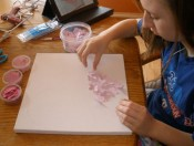Arranging butterfies on canvas.