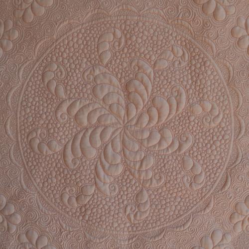 Renae Allen's Quartro Decennie quilt - close-up of fill stitches.