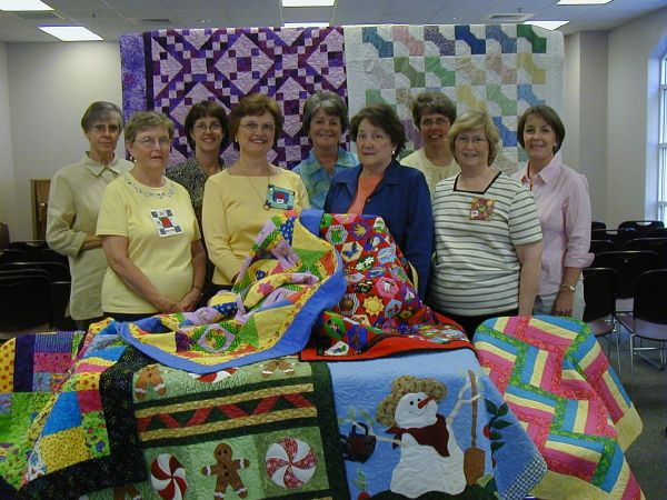 Sewn In Love quilting volunteers