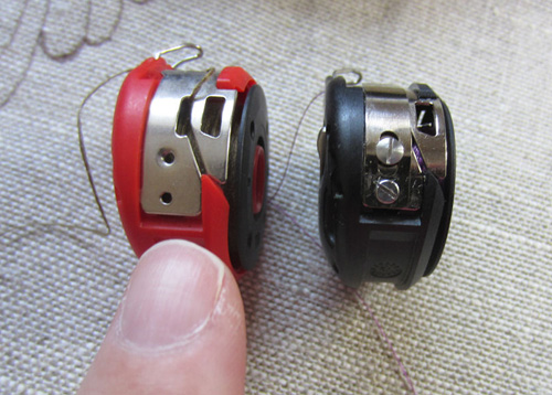 red bobbin and regular bobbin