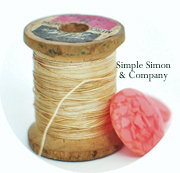thread spool - Simple Simon & Co logo