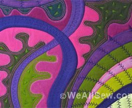 pink - purple - green quilt with decorative stitches