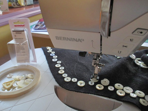 Georgia Bonesteel sewing on buttons on her BERNINA machine