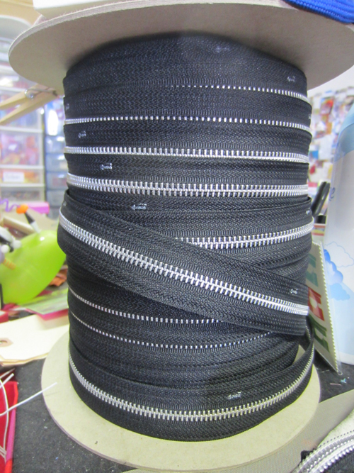 reel of black zipper tape