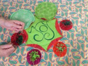 First six yo-yo's stitched onto quilt