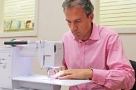 man at sewing machine