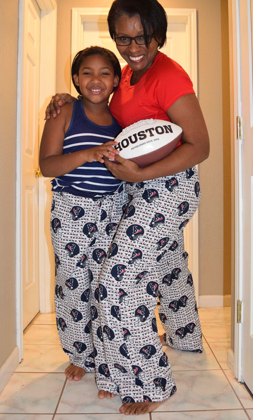 woman and girl in matching pajamas