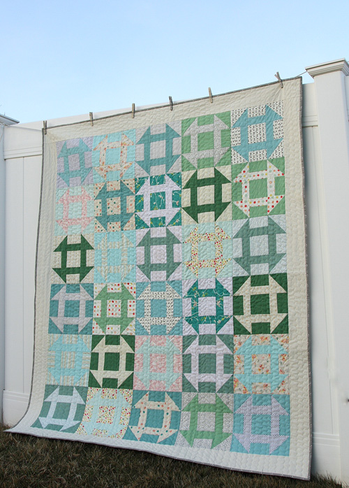 Churn-Dash-Sew-Along-with-Amy-Smart-turquoise-quilt-on-gate