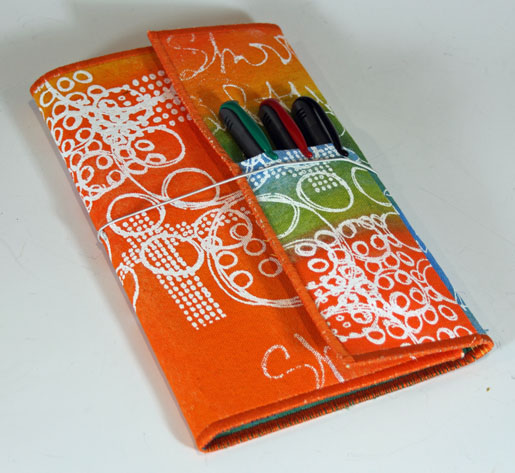 notebook folio with pens