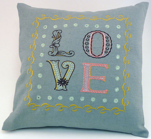 pillow with embroidery and eyelets