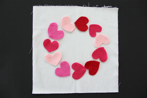 Placing felt hearts