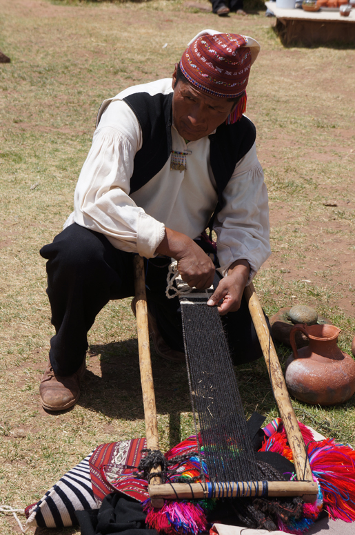 weaving a sash in Peru