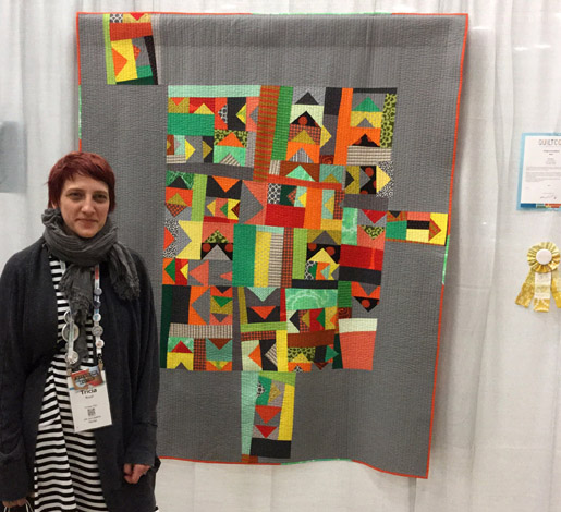 Tricia Royal with her quilt, This Way