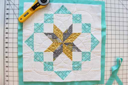 remove excess batting on all sides of the quilt