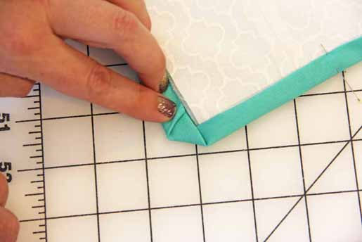 Fold in dog ear when binding your quilt