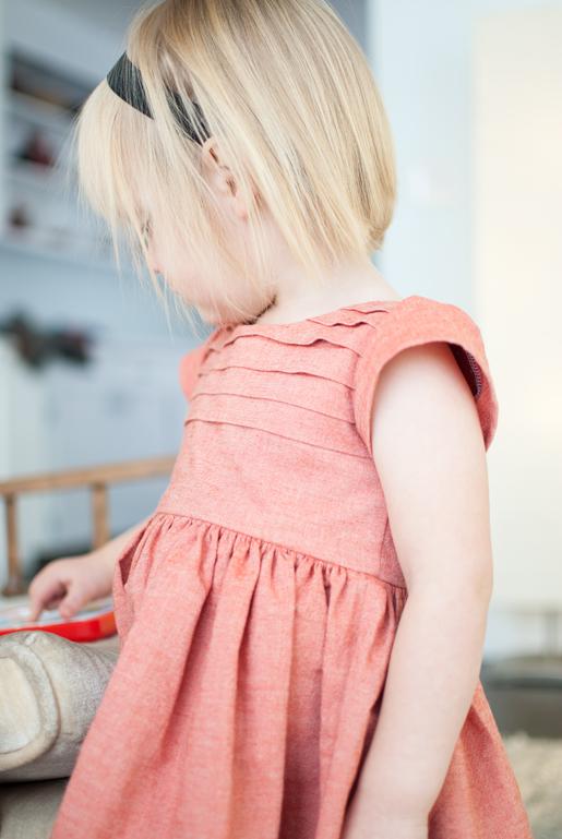 girl wearing pleated bodice dress