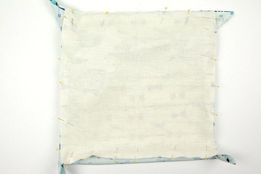 """Fold and press the 16"""" x 16"""" piece of fabric"""