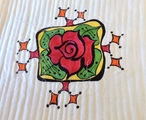 Add quilting to make a thread painted rose tile pillow