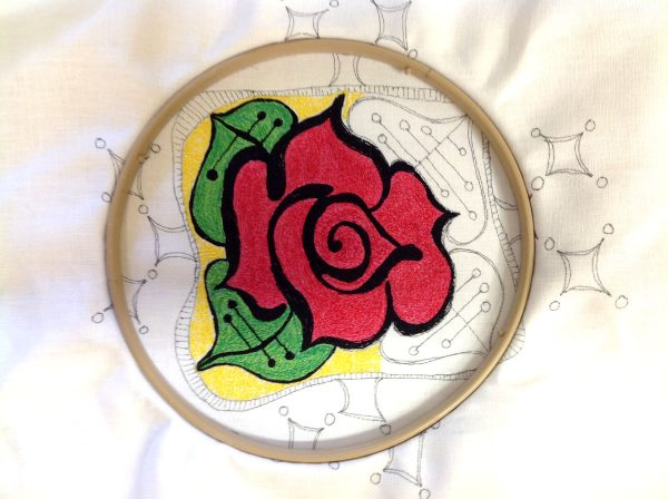 Re-hoop the design to make a thread painted rose tile pillow