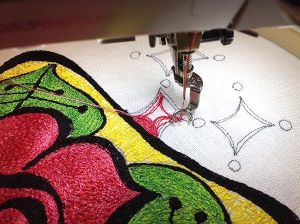 Thread paint squares to make a thread painted rose tile pillow