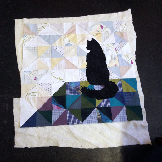 Use temporary spray adhesive on the quilt front