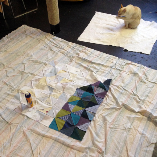 Use temporary spray adhesive to baste the quilt