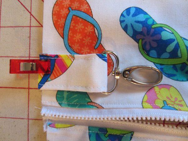 Swim Wetbag Sewing Tutorial - Slip one end through lobster claw clasp