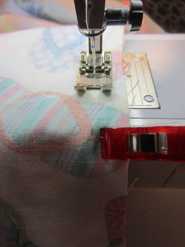 """8.Sew around the entire bag, leaving a 4"""" opening at the bottom edge of the exterior panel."""