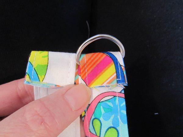 Slide remaining strap material through D-ring