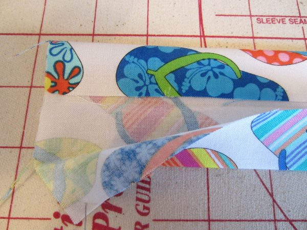 "Swim Wetbag Sewing Tutorial - 5.	Fold 4 x 18"" strip in half lengthwise"