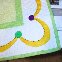 Tape Measure Stitch Tip - Closeup of Measuring Tape Border