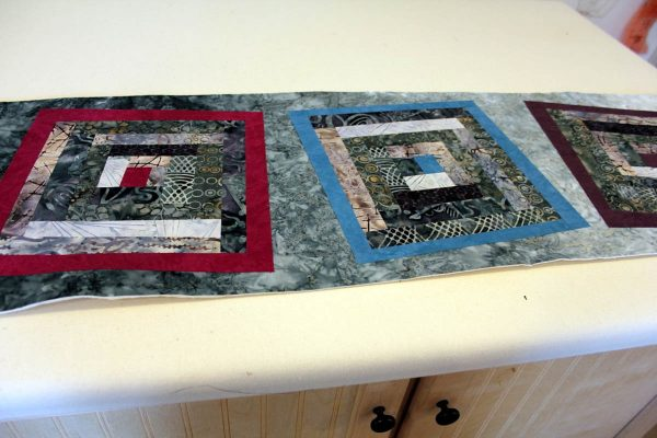 Fused Log Cabin Table Runner Tutorial - fuse blocks on top of background fabric