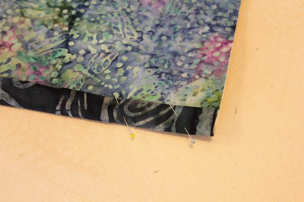 Fused Log Cabin Table Runner Tutorial - Fold the binding strips toward the back, pin in place
