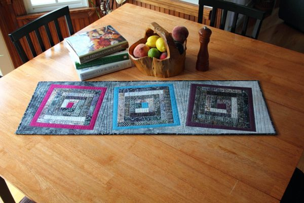 Fused Log Cabin Table Runner Tutorial - finished table runner on table