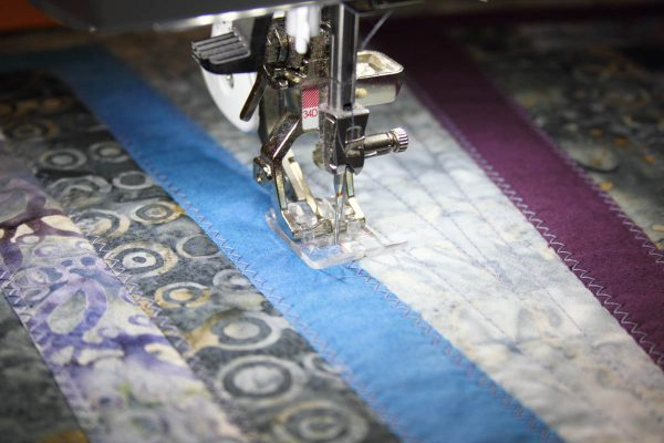Fused Log Cabin Table Runner Tutorial - zigzag stitch over raw edges