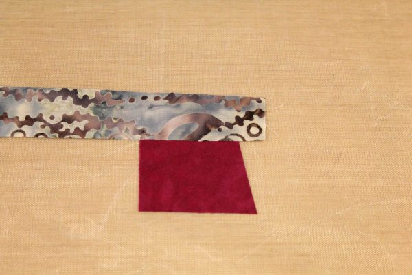 Fused Log Cabin Table Runner Tutorial - placing strip along the top edge
