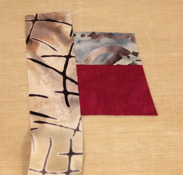 Fused Log Cabin Table Runner Tutorial - Place strip along the left edge of the center square