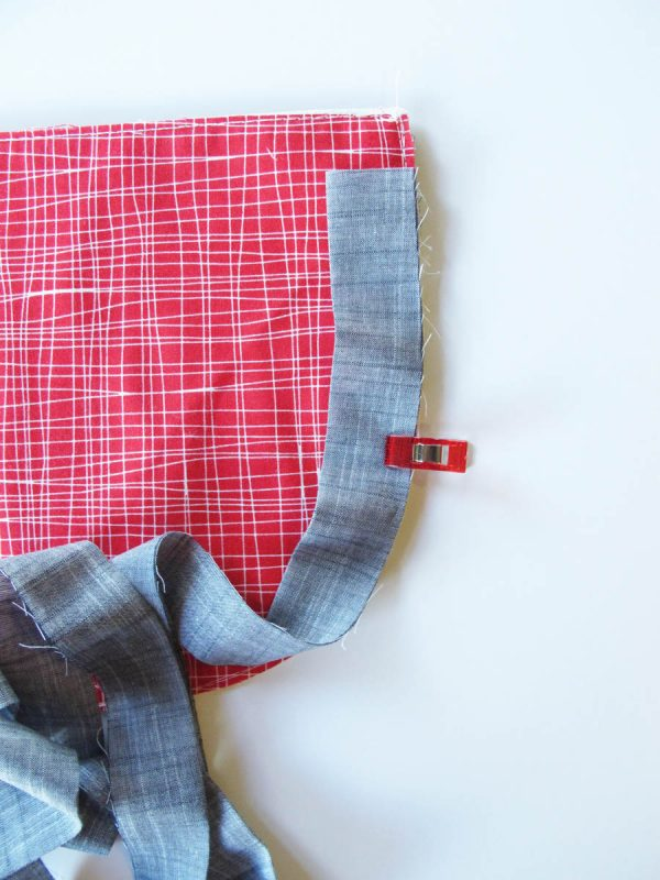 Vinyl Zip Pouch Tutorial - start sewing the raw edge