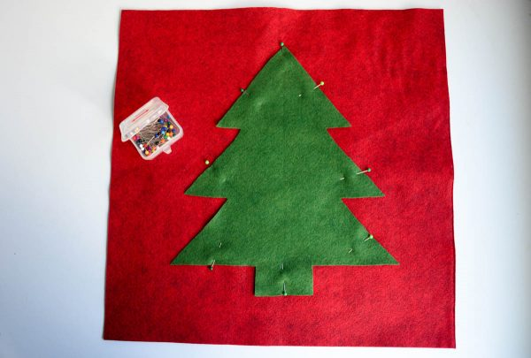 Christmas Tree Pillow Tutorial - Place the tree in the center of one of your felt squares and pin in place