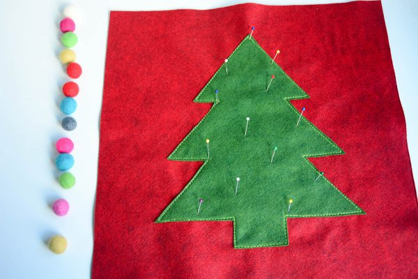 Christmas Tree Pillow Tutorial - place the pom poms in a line i