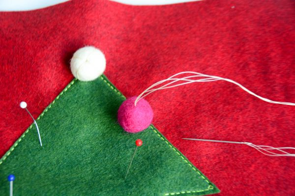 Christmas Tree Pillow Tutorial - Push the needle through the center of the pom pom