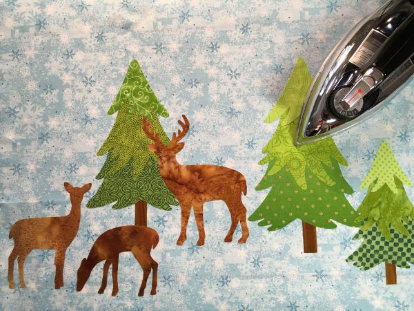 Mantel Cover Tutorial - add the trees and deer to each end of your background fabric