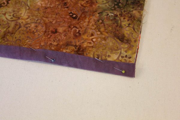 Fabric Message Board Tutorial - pin the binding strips in place