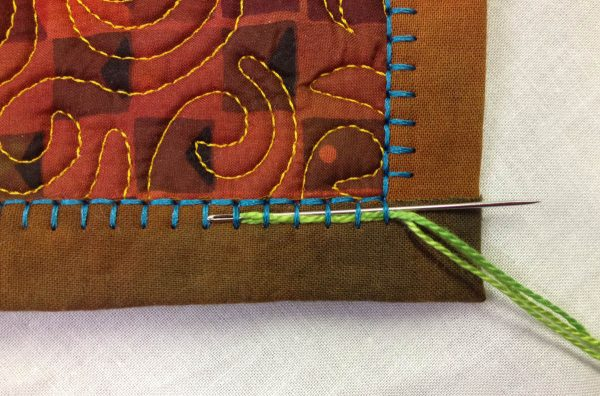 Embellishing the Blanket Stitch - needle under six stiches
