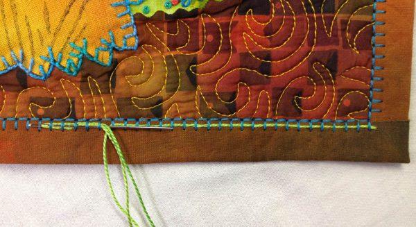Embellishing the Blanket Stitch - needle under remaining stitches