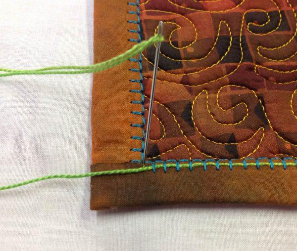 Embellishing the Blanket Stitch - needle at corner