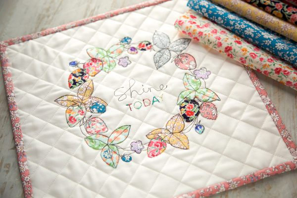 Embellishing a mini quilt with free motion and applique